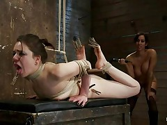 Brunette chick with pretty face and hot ass is getting whipped by this babe with big tits. She has laundry pliers on her toes and tongue and it looks like she enjoys the pain. After whipping her she starts fisting her oiled vagina first with one hand and then with both of them. Her pussy barely takes it but she has to endure her treatment because she's tied up really good. When she finishes using her hands and a vibrator to fuck that pussy, the busty babe starts to untie her, what's going to happen next?