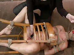 I just love tied up chicks that are getting their pussy fucked. This one, Chanel Preston, is a hot slut and she's tied on that chair while a women fingers her pink pussy and then leaves her there on the floor, just look at those big hot breasts and pretty face. In the next scene this hot slut has her tits tied with rope and only her nipples are out, she gets whipped on those hard nipples and sexy booty. Perhaps her pussy is all wet now and she wonders what will happen to her next.