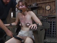 We don't know what Hazel did but she really got herself in some big problems. Look at her now how she is being tortured, with electrodes on her pussy and squeezing devices on those fragile tits. She moans and endures everything! A long and hard punishment awaits the skinny chick so don't miss it, she surely won't!