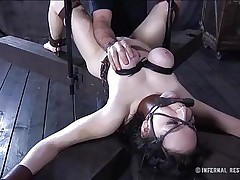 This brunette is milky white and her pussy is so tight and perfect that they had to gape it and reveal the inside of it. Enjoy watching this bitch in a uncomfortable position as her big soft boobs are squeezed and sucked and her mouth gagged. Four clamps are added on her delicious pussy to gape it for our sight