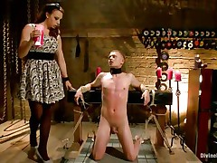 Micah Andrews is tied up so he can't move while mistress Chanel Preston drips hot candle wax all over his body. She drips the wax on his chest, tongue, and cock and balls. After choking him until he gasps for air, she whips his tiny cock red.