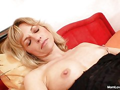 Joanna loves her vibrator and shows us what she can do with it. She spreads her sexy legs and then rubs and fingers her cunt before inserting that sex toy in her pussy from behind making us horny. She is all alone, masturbating with lust and we hope to see her getting fucked from behind by a real cock.