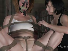 This is how these girls like to play. Cici is all tied up and has a mask on her face while her brunette girl takes advantage of her body. She squeezes her nipples and tongue and then begins rubbing that sweet pussy with a vibrator.