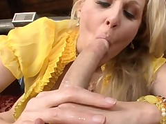 Breasty older hottie is sucking on dude's pecker hungrily