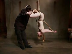Pretty and with an amazing body the milky white chick receives an humiliating and rough treatment from her executor. He tied her up and hanged the bitch upside down and now gapes her pink pussy really hard. After taking care of her cunt it's time for the other hole so he rubs it with the vibrator and fingers it