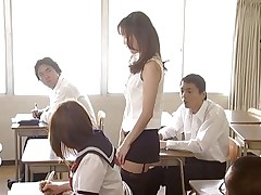 Manami Suzuki loves teaching. Someone's out to expose her for the slut she really is, hitting the remote control of her vibrator, causing her to moan as she walks through the class. A student's father comes in, his son saying the teacher's a porn star. Soon she's stripped in front of the class.